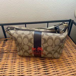 Small hand coach purse
